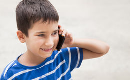 Boy talking on the phone Stock Photo
