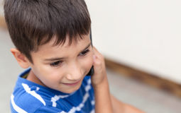 Boy talking on the phone Stock Photos