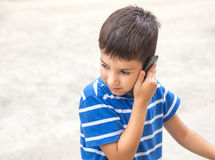 Boy talking on the phone Stock Image
