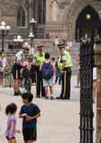 Boy Talking with Police on Parliament Hill Stock Image