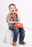 boy talking on a retro telephone. Stock Photography