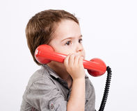 Boy talking on a retro telephone. Royalty Free Stock Photos