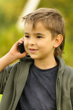 Boy talking to a cell phone Royalty Free Stock Photography