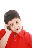 Boy talking to cell phone Royalty Free Stock Images