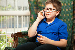 Boy talking to his dad by phone Royalty Free Stock Photo