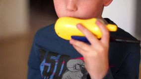 Boy talking with walkie talkie stock video footage