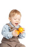 Boy with tangerines Stock Photography