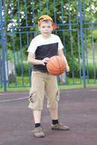Boy tapping basketball Royalty Free Stock Photo