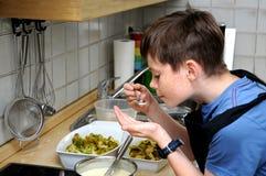 Boy tasting sauce Stock Image
