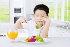 Boy tasting vegetables salad Stock Images