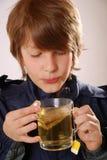 Boy with tea Stock Photos