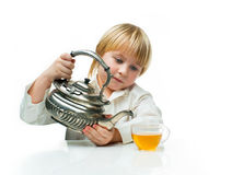 Boy with tea Stock Photos