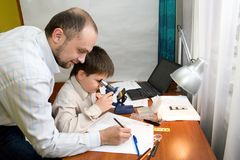 Boy with teacher in the laboratory Royalty Free Stock Photos