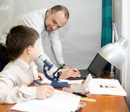 Boy with teacher in the laboratory Stock Images