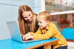 Boy And Teacher At Laptop Computer Stock Photo - Image of playschool