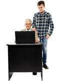 Boy teaching grandfather how to use a laptop Royalty Free Stock Photo