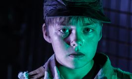 War and childhood. The boy in tears, sweating, in camouflage clothes. War and childhood Royalty Free Stock Photo