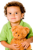 Boy With Teddy. A smiling happy young boy with teddy bear on white background stock photo