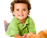 Boy With Teddy. A smiling happy young boy with teddy bear on white background stock images