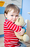 Boy with teddy bear Stock Images