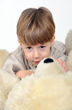 Boy with a teddy bear Stock Images