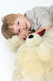 Boy with a teddy bear Royalty Free Stock Photo