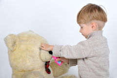 boy with a teddy bear Royalty Free Stock Images