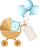 Boy teddy bear in baby carriage with label tag Royalty Free Stock Image