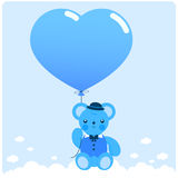 Boy teddy bear and balloon. A cute newborn baby boy teddy bear in the sky holding a heart balloon Royalty Free Stock Images