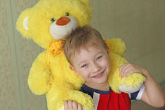 Boy with Teddy bear Stock Photos