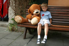 Boy and teddy bear. Royalty Free Stock Photos
