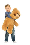 Boy with a Teddy bear. Small blonde boy hugged the big Teddy bear - Isolated on white background Royalty Free Stock Images
