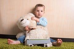 Boy with teddy bear Stock Photos
