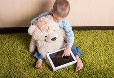 Boy and teddy bear Stock Photography