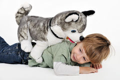 boy with a teddy dog Royalty Free Stock Images