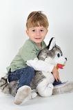 boy with a teddy dog Royalty Free Stock Image