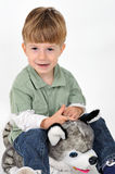 Boy with a teddy dog Stock Photography
