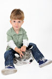 Boy with a teddy dog Stock Images