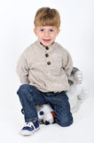 Boy with a teddy dog Stock Image