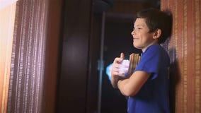 Boy teen book reading is wall indoor education stock video