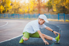 Boy Teen doing sports exercises on a stadium Stock Image