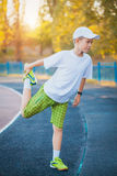 Boy Teen doing sports exercises on a stadium royalty free stock image