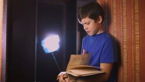 Boy teen reading education book is wall indoor stock video