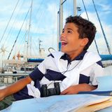 Boy teen sailor laying on marina boat chart map Stock Image