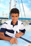 Boy teen sailorsitting on marina boat chart map Royalty Free Stock Photos