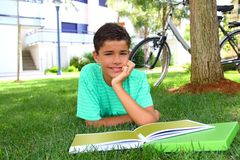 Boy teen studying laying green grass garden Royalty Free Stock Photography