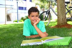 Free Boy Teen Studying Laying Green Grass Garden Royalty Free Stock Photography - 16508387