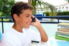 Boy teen talking mobile phone smiling student. Boy teen talking mobile phone happy smiling student outdoor garden stock photos