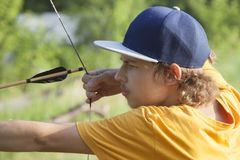 Boy teenager archer aiming arrow.  Stock Images