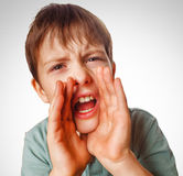 Boy teenager calling cries kids shouts opened his. Mouth isolated on white background gray Royalty Free Stock Images
